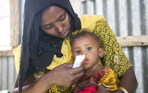 GOAL – Ethiopia – 2018: 23 year-old mum, Merema Ali, with her one year-old baby boy at Berhale refugee camp, in Ethiopia's Afar region, where GOAL provide nutritional and other supports. Photo: Anteneh Tadele