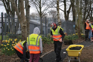HARD AT WORK: COMMUNITY AND STUDENTS INSTALL A NEW GARDEN PATH