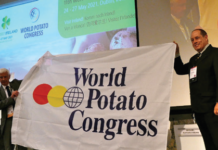 The World Potato Congress flag handover ceremony took place in Cusco, Peru when Juan Jose Risi (Vice-minister for Agriculture and Irrigation, Peru), presented The WPC flag to Liam Glennon, (Chairperson of The 2021 World Potato Congress Organising Committee) in Cusco, on 29 May 2018.