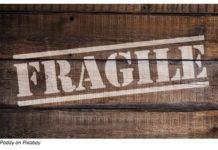 fragile written on a box