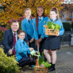 Agri Aware chairman Alan Jagoe with 5th class students from Scoil Ide Presentation Primary School in Clondalkin, Co Dublin in December when the Incredible Edibles 2020 school programme was launched. The programme has now been launched to families in the form of Incredible Edibles Family Challenge to help educate and entertain children about the importance of Irish fruit and vegetables during the current period of school closures.