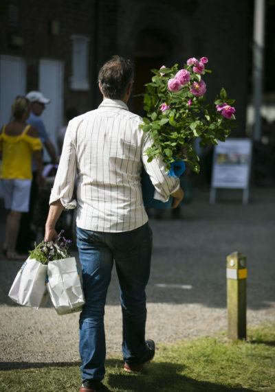 A man carrying flowers