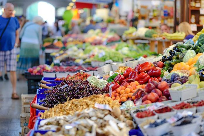 An image of fruits and vegetables in a market