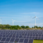 solar-power-panels-with-wind-turbines-A5UUTG3