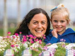 Woman and child behind flowers