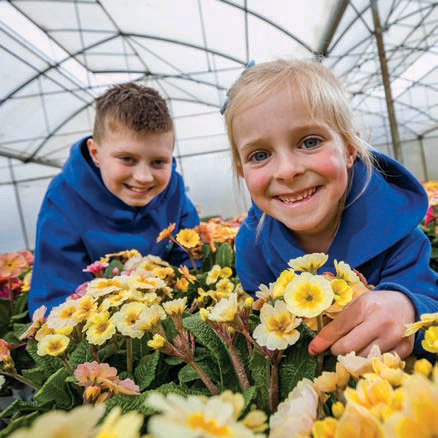 Boy and girl with flowers